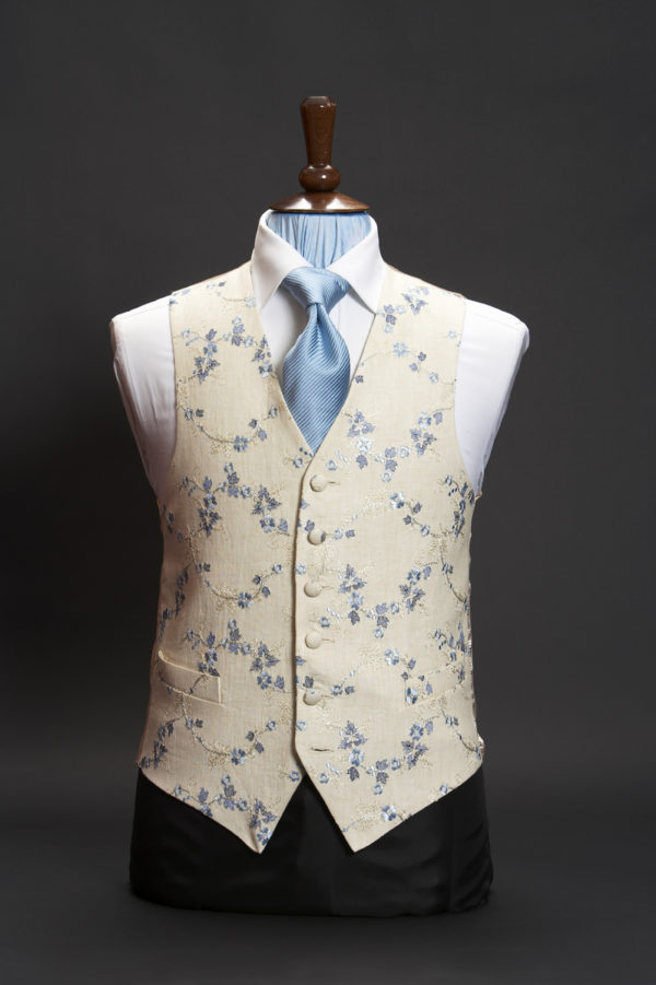 Cream linen waistcoat with blue floral embroidery