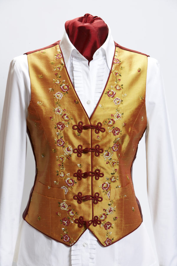 Ladies gold silk waistcoat with floral embroidery and red silk frogging and piping