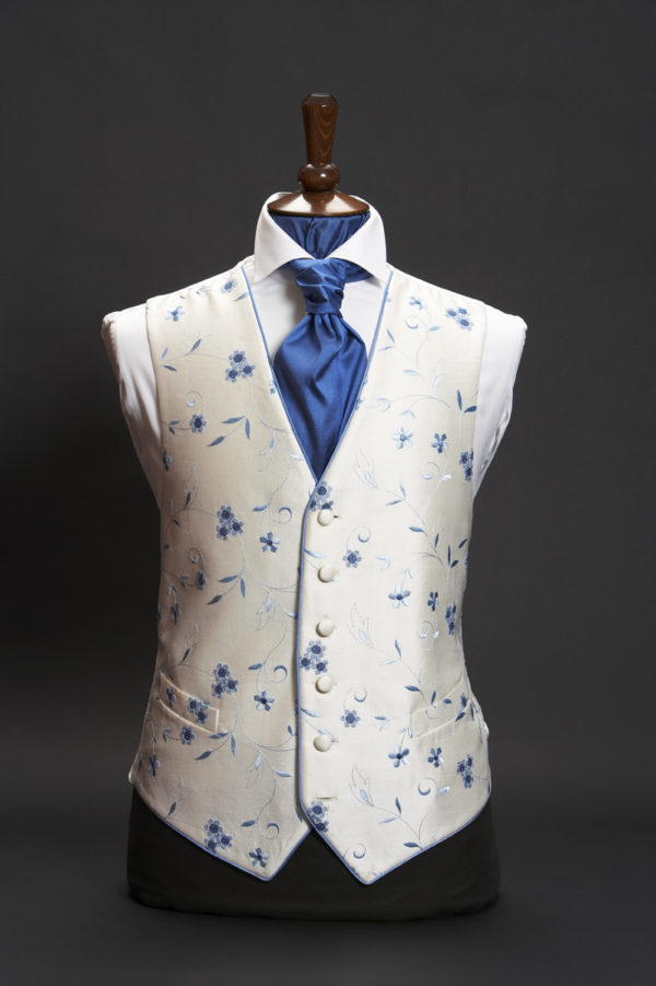 Ivory silk waistcoat with blue embroidery and blue piping