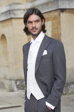 Lightweight grey herringbone morning coat with matching grey herringbone wool trousers