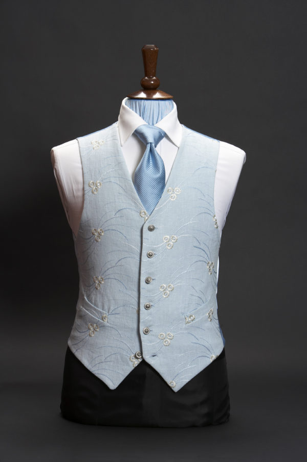 Blue linen waistcoat with ivory embroidery