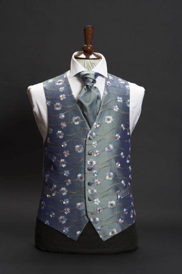 Petrol blue silk waistcoat with daisy embroidery