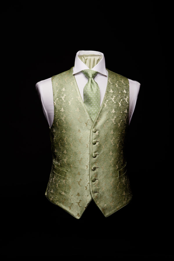 Green silk roses with ivory waistcoat and green silk piping