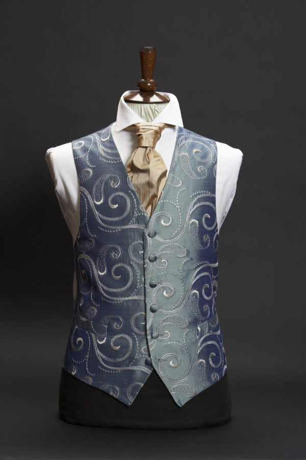 Petrol blue silk waistcoat with large silver grey swirl embroidery