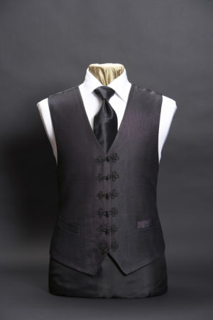Black silk lurex waistcoat with frogging