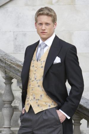 Lightweight wool black herringbone morning suit with grey stripe trousers