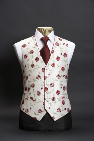 Ivory silk embroidered waistcoat with red roses and piping