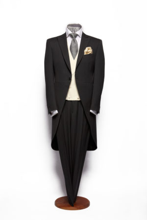Charcoal grey herringbone three-piece morning suit including a waistcoat