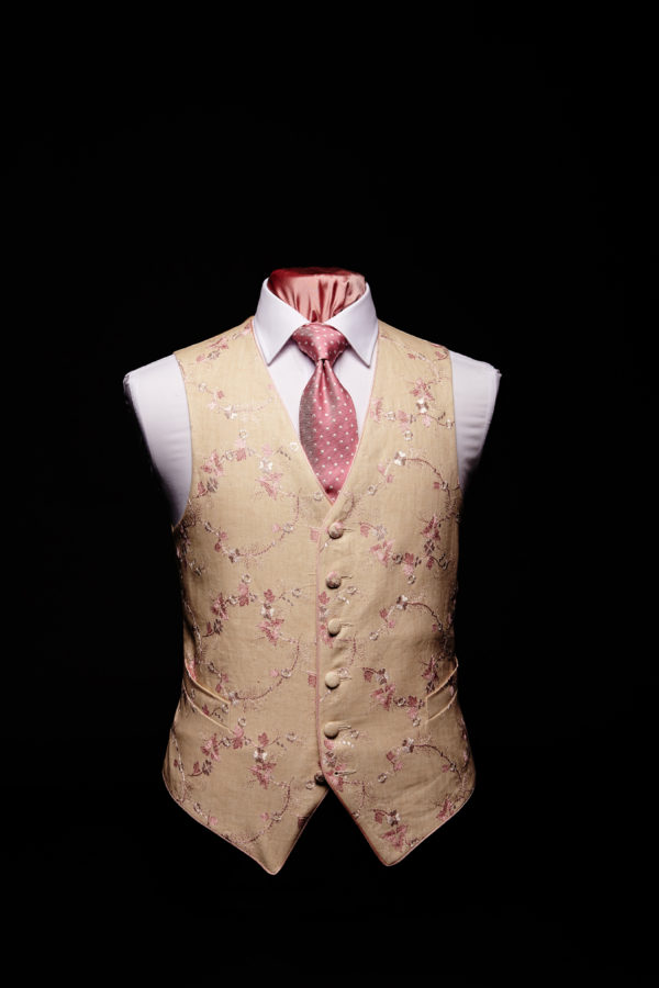 Cream linen waistcoat with pink embroidery with pink silk piping