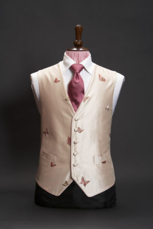 Muted pink silk waistcoat with pink embroidered butterflies and piping